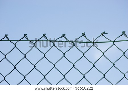 New wire security fence over sky - stock photo