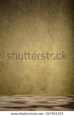 New wooden board and burlap background. Toned.