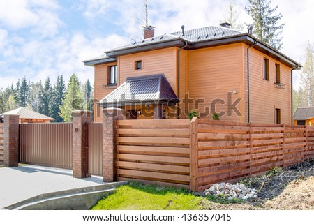 new wooden country house in the forest - stock photo