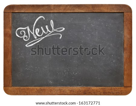 new word- white chalk text  on a vintage slate blackboard - stock photo