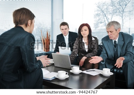 New worker in an interview with three business people getting bad results - stock photo