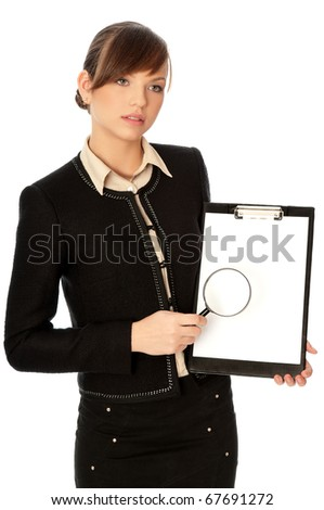 New worker looking at the white blank paper with a magnifier - stock photo