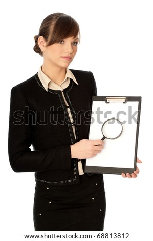 New worker making presentation with the white blank paper and a magnifier - stock photo