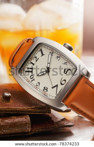 New wristwatch and old rusty wallet closeup - stock photo