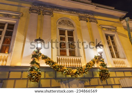 New Year and a Christmas lights decoration on the old town house. Moscow, a fragment of the facade of the old mansion on Tverskoy Boulevard