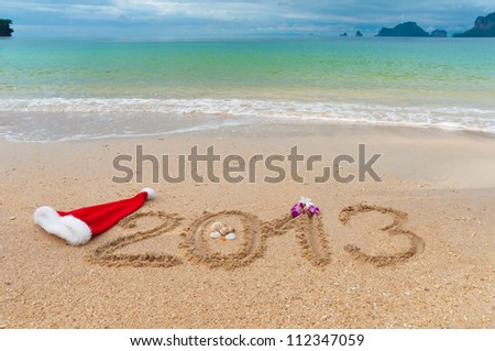 New year 2013 and Christmas beach vacation and holiday concept. 2013 written on tropical beach sand - stock photo