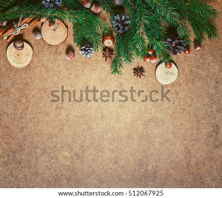 New year and Christmas card. Holiday and celebration concept.  Fir branch with Christmas spices and nuts. Christmas background.