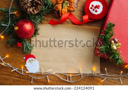 New Year background: decorations and blank sheet for the greetings - stock photo