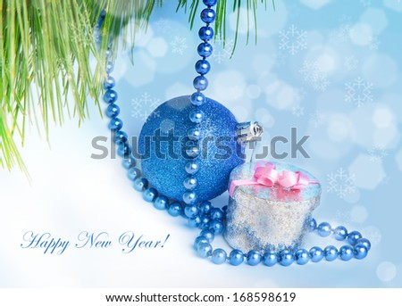 New Year background with blue decoration ball and silver gift