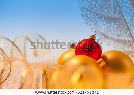 New Year background with golden ribbon, glass toys and presents - stock photo