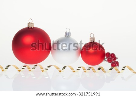 New Year background with three golden glass New Year toys and branch of rowan - stock photo