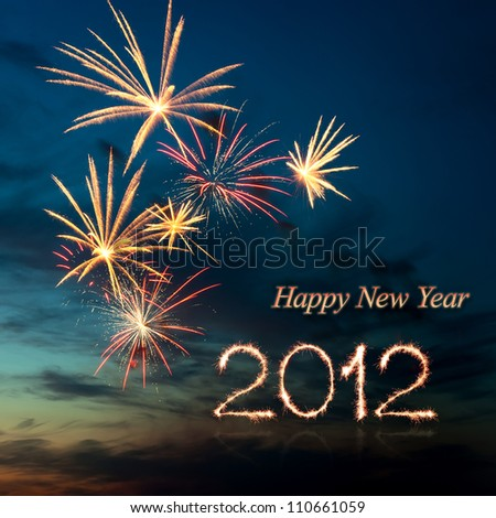 New year 2012 brightly colorful fireworks and salute of various colors in the night sky - stock photo