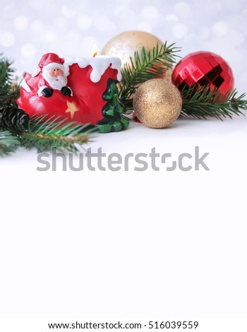 New year card. Christmas decorations, red and gold balls, candle holder Santa Claus.