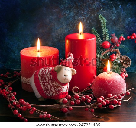 New year card with a candle and a  sheep, a symbol of 2015, background with space for text - stock photo