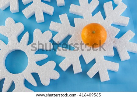 New Year card with blue balls and beads, white snowflakes foam, orange tangerines, tinsel and fir branches - stock photo
