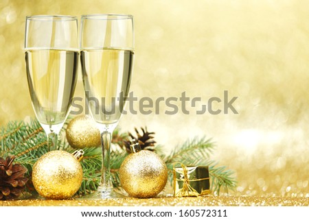 New year card with champagne and decoration - stock photo