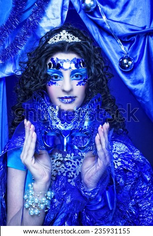 New Year Carnival. Portrait of young brunette in creative holiday image. - stock photo