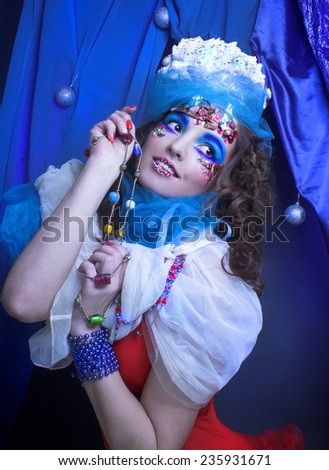 New Year Carnival. Portrait of young woman in creative image. - stock photo