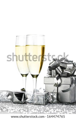 New year cars with Champagne glasses and gifts - stock photo