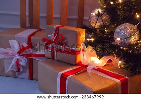 New Year, celebration. Beautiful, shiny Christmas tree with gifts