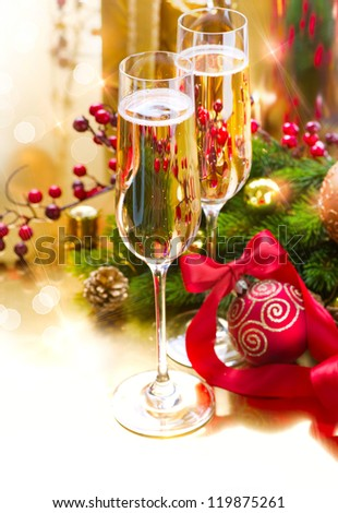 New Year Celebration. Christmas.Two Champagne Glasses on Holiday Setting Table - stock photo