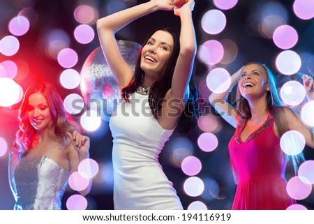 new year, celebration, friends, bachelorette party, birthday concept - three beautiful woman in evening dresses dancing in the club - stock photo