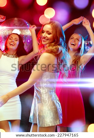 new year celebration, friends, bachelorette party, birthday concept - three beautiful woman in evening dresses dancing in the club - stock photo