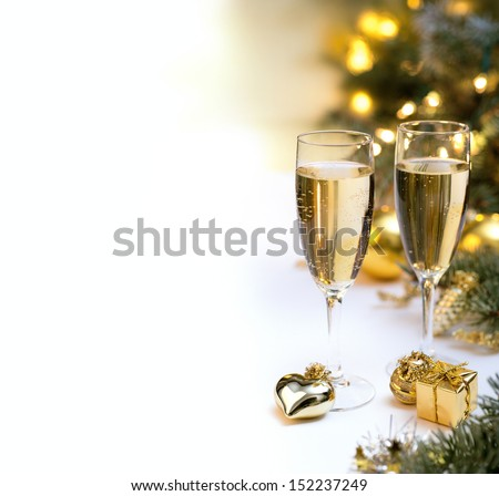 New year celebration table with two champagne glasses