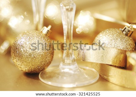 New year champagne glasses and golden decoration - stock photo