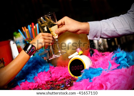 new year champaign toast over clock midnight - stock photo