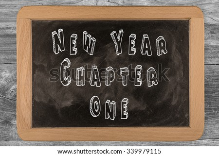 New Year Chapter One - chalkboard with outlined text - on wood