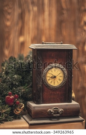 NEW YEAR, CHRISTMAS: Christmas Vintage Wooden Clock with Winter Decoration on Wooden Background - stock photo