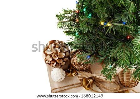 New Year & Christmas still life of decorated and wrapped gift under spruce branches isolated on white. - stock photo