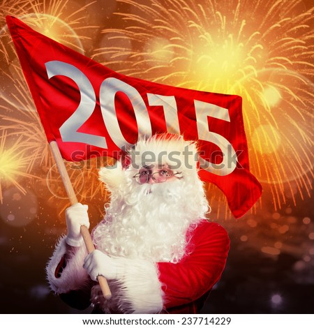 New year coming by Santa Claus. Santa with 2015 flag in firework flashes - stock photo