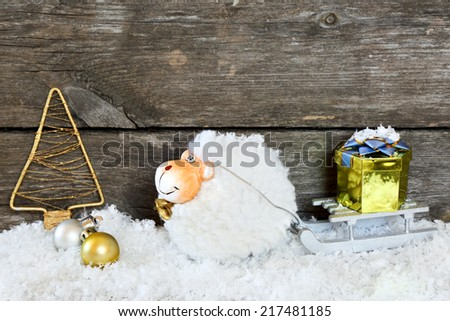 New Year composition with a sheep - a symbol of 2015 on east calendar, on a white background. space for text. - stock photo