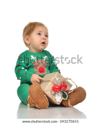 New year 2016 concept child baby toddler kid with rustic Christmas present gifts for celebration isolated on a white background - stock photo