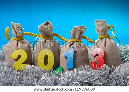 New year concept.Four bags with 2013 digits on blue background - stock photo