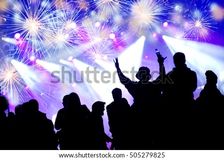 New Year concept with celebrating crowd and fireworks