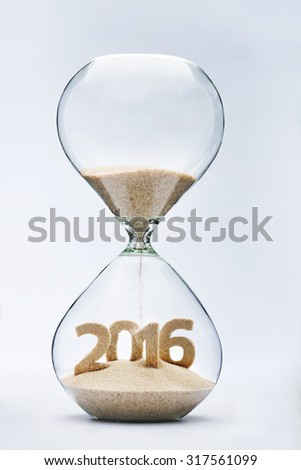 New Year 2016 concept with hourglass falling sand taking the shape of a 2016 - stock photo