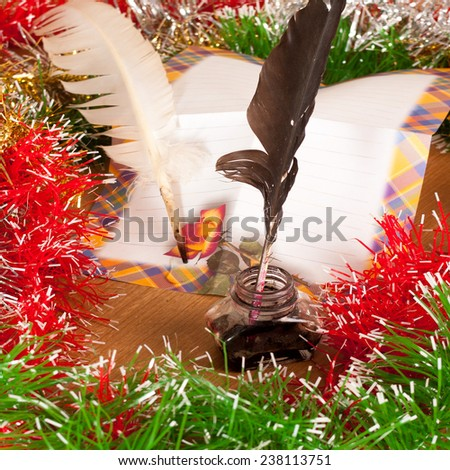 New Year Decoration and blank love letter with Feather Pen and Ink Well - stock photo