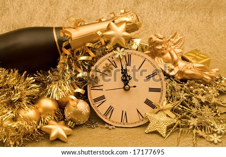 new year decoration on golden background - stock photo