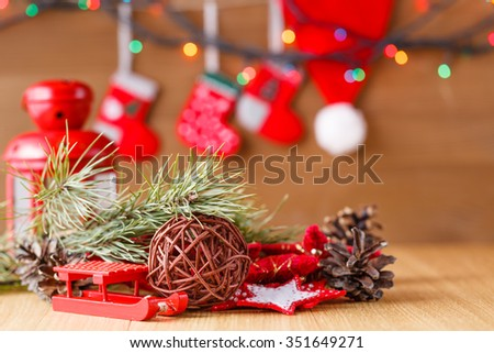 New year decoration on table with Christmas tree garland