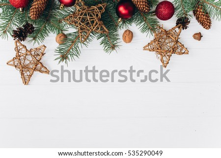 New year decorations on the white wooden background.