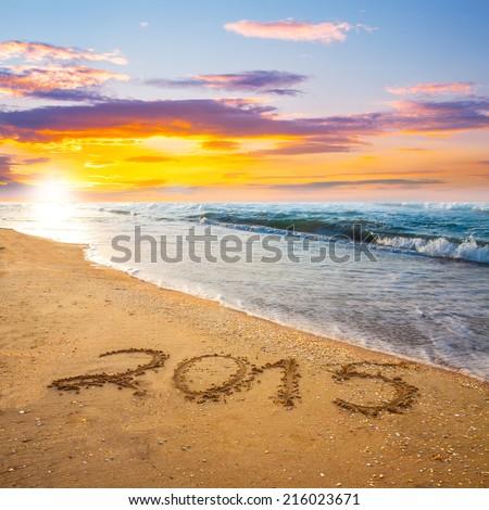 new year 2015digits on ocean beach sand - stock photo