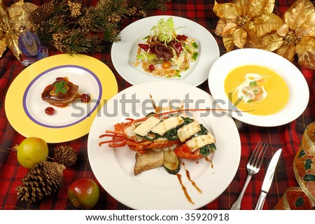 New Year dinner with a cooked lobster plate.  Christmas dinner.  Lobster dining. Tasty plate of seafood meal on it with fresh cooked lobster flavored .
