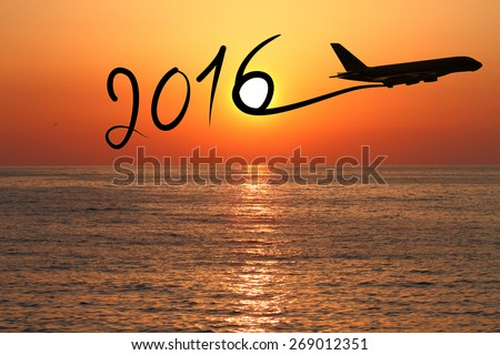 New year 2016 drawing by airplane on the air at sunset - stock photo