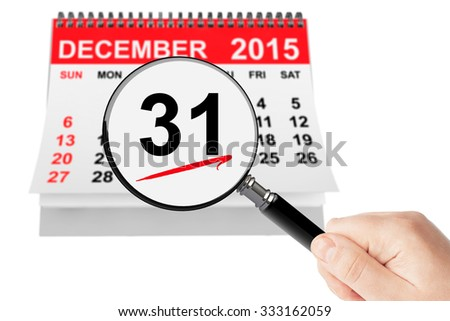 New Year Eve Concept. 31 December 2015 calendar with magnifier on a white background - stock photo