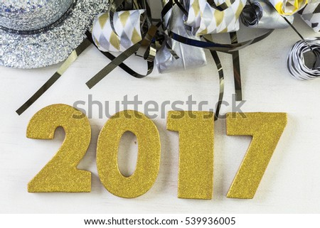 New Year Eve party decorations with year on a white background.