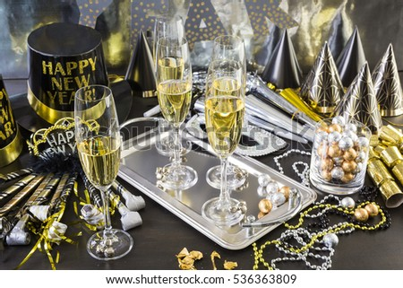 New Year Eve party with champagne and chocolates.