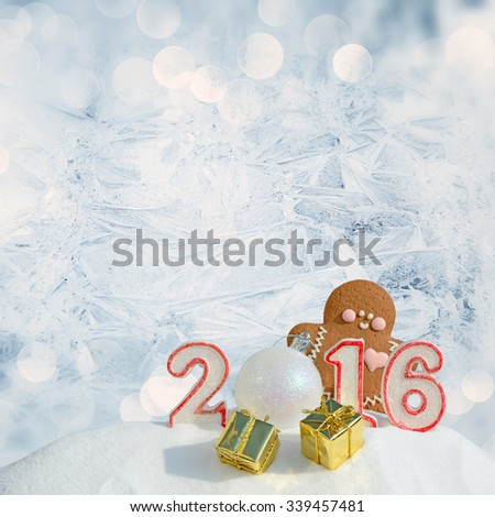New Year 2016. Figure 2016, Christmas balls, gifts and gingerbread man on a festive background - stock photo